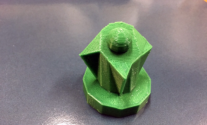 3D model printed in green plastic, with ribbed surfaces