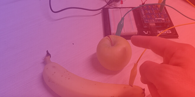 Capacitive touch experiment: A banana and an apple used as capacitive touch sensors